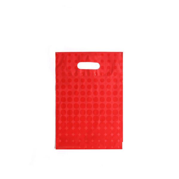 Plastposer rød med sirkler 25x35 cm | Uten trykk | SKG - Spesialister innen profilert emballasje